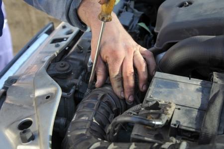 servicing: Car servicing, replacing of air filter, fixing hose clamp