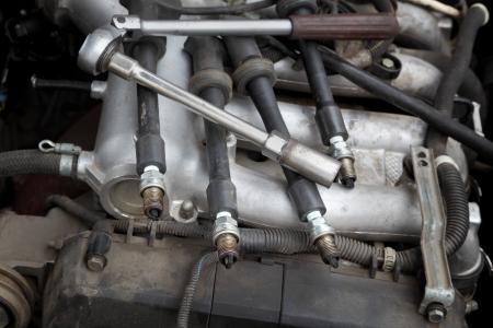 ratchet: Modern car gasoline engine servicing,  ratchet tool and spark plug
