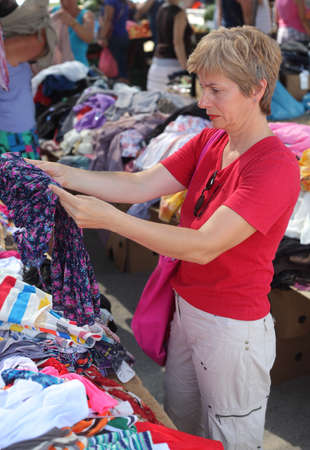 Mid adult woman shopping at flea market, real people no retouching photo
