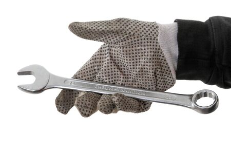 Mechanic hand  hold spanner  tool in hand isolated on white photo