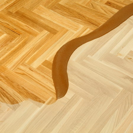 treated board: Varnishing of oak parquet floor, first layer of lacquer