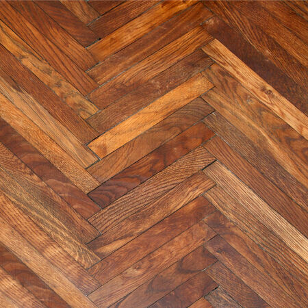 treated board: Varnishing of oak parquet floor, first layer of lacquer at old wood Stock Photo