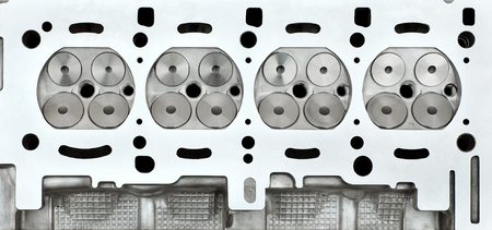 Car engine cylinder head, four valve construction Reklamní fotografie