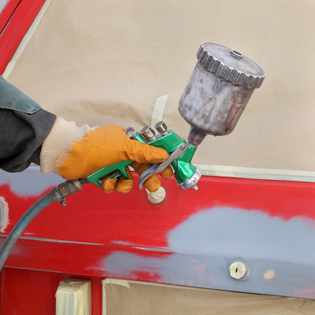 paintjob: Car ready for repaint, worker hand and car airbrush