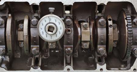 crankshaft: Crankshaft in block of car engine with instrument for angle measure Stock Photo