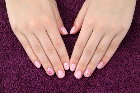 Finger nail treatment,hands with painted fingernails
