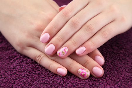 nailcare: Finger nail treatment,hands with painted fingernails