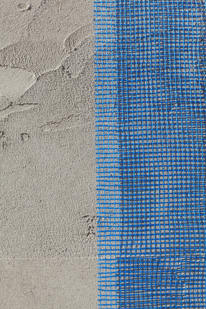 construction mesh: Closeup of layers over styrofoam insulation, mesh, plaster, cement, mortar