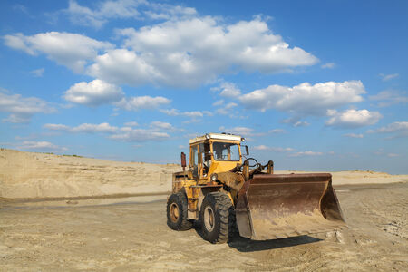 sand quarry: Sand quarry, excavating equipment, bulldozer with heap of sand in background