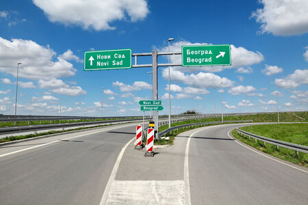 New highway crossroad in Vojvodina, Serbia known as corridor 10 with sign for Belgrade and Novi Sad photo
