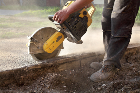 blade cut: Asphalt or concrete cutting with saw blade at construction site