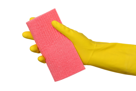 Human hand in glove holding sponge rag, dish rag isolated on white photo