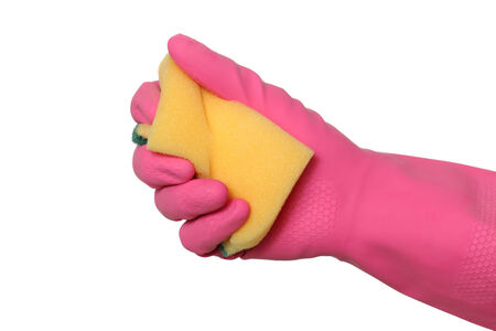 Human hand in glove squeeze sponge, isolated on white photo