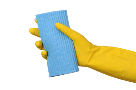 Human hand in glove holding sponge rag, dishrag isolated on white photo