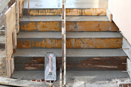formwork: Wooden formwork for concrete staircase at construction site