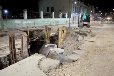 open trench: Hydro construction work, reconstruction of sewerage, night photo