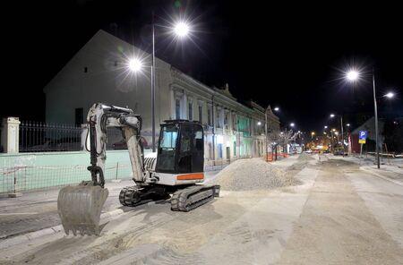 Bulldozer at construction site, reconstruction of street, roadwork, Zrenjanin, Serbia,  night photo