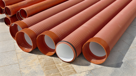sewerage: Heap of new plastic tubes for sewerage pipeline Stock Photo