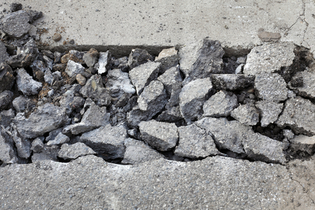 demolishing: Asphalt after demolishing with jackhammer tool at construction site
