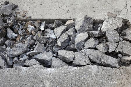 demolishing: Asphalt after demolishing with jackhammer tool at construction site