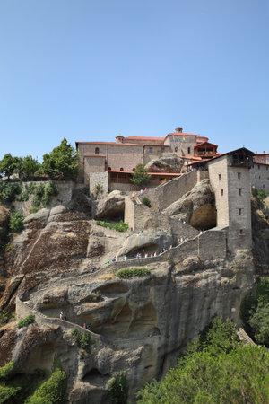 kalampaka: METEORA, GREECE-28 JUL 2016,  Holy Monastery Great Meteoron, Meteora, Greece, pilgrims coming to monastery by stairs Editorial