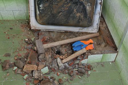 demolished: Home renovation, old bathtub and tiles demolishing in bathroom