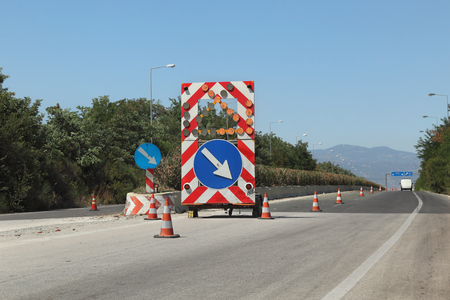 Roadworks, road signs at a road in Greece at E75 highway from Thessaloniki to Athens Stock Photo