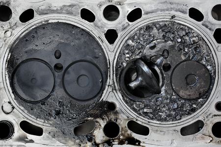 Car engine cylinder head with broken valve, two valve construction