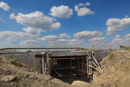 Roadworks, small bridge at highway or road on reconstruction with blue sky and clouds Stock Photo