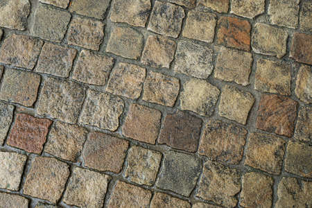 Background from paving stones. Texture of stone pavement for the road. 写真素材