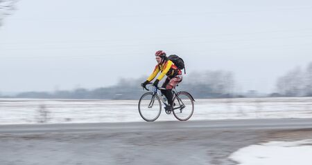 panning shot: Klimovsk, Moscow Region, Russia - April 4th, 2015: Moscow cycling club Caravan event - 200km brevet(randonneuring, audax). Man riding his bike, panning shot.  Editorial