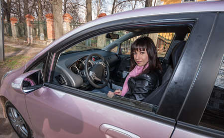 brown  eyed: Girl with pink scarf inside pink car