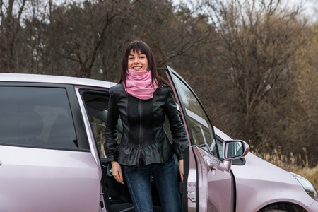 get out: Girl with pink scarf get out from pink car