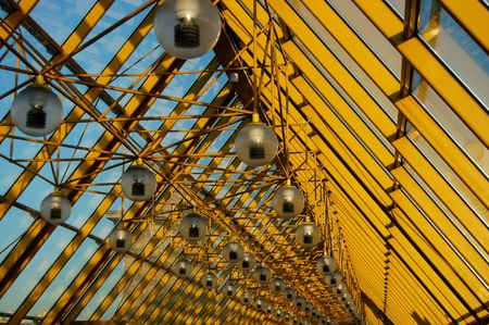 acute angle: row of lamps on yellow  Stock Photo