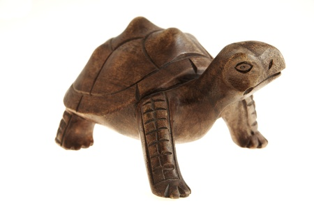 Statue of a turtle made of wood.