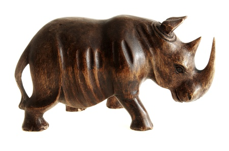 primitivism: Figurine of rhinoceros made of wood. Stock Photo