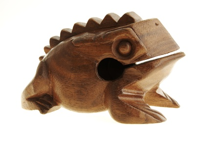 Figurine of a frog from the tree. photo