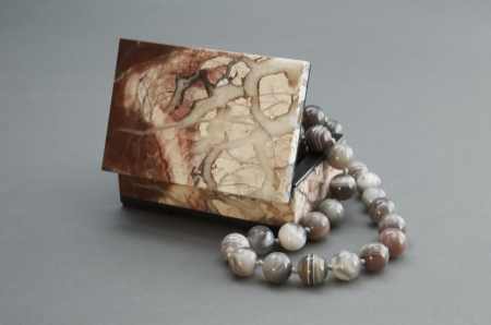 Stone box with the beads. photo