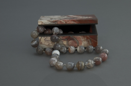Stone box with the beads.