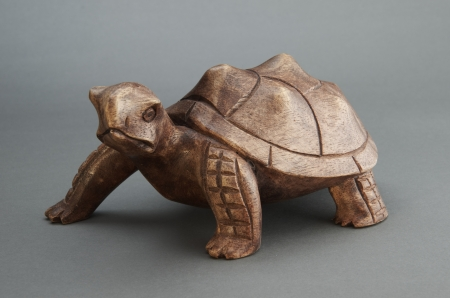 Statue of a turtle made of wood. Stock Photo - 17125081