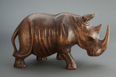 Figurine of rhinoceros made of wood. Stock Photo - 17125085