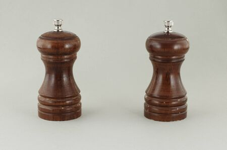 Two pepper shakers made from the tree. photo