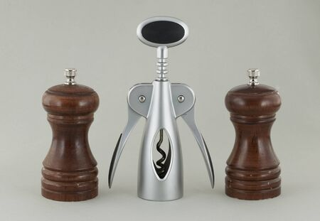 Two pepper shakers made from the tree and corkscrew. photo