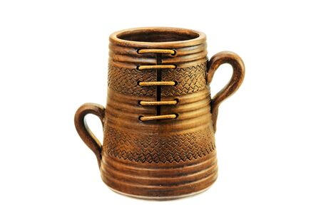 Ceramic mug with two handles on a white background.