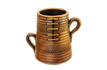 Ceramic mug with two handles on a white background. photo