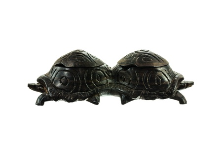 Wooden figurine two turtles on a white background. Stock Photo - 17834472