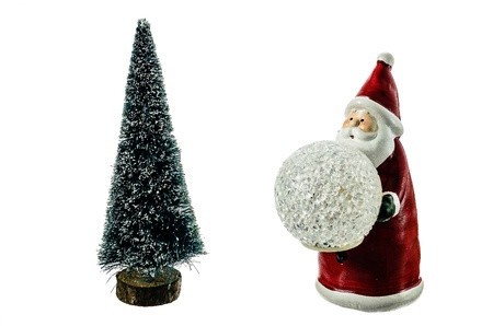 The figure of Santa Claus and Christmas tree on a white background. Stock Photo - 18132632