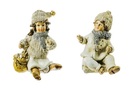 Ceramic figures of a boy and a girl on a white background. photo