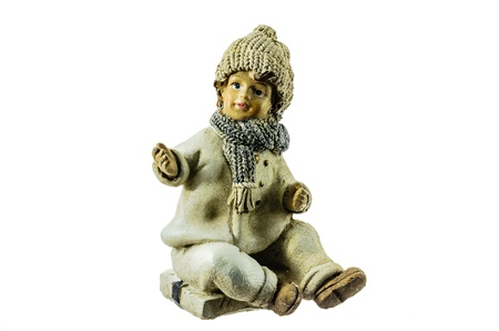 Ceramic figures of a boy on a white background. photo