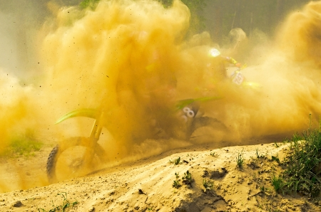 LYTKARINO, MOSCOW REGION, RUSSIA - 18 MAY 2013: motocross cup motor club Forsazh. Overcoming a sharp turn in the dust.